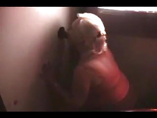 Amateur platinum tow-haired blows nearby the gloryhole