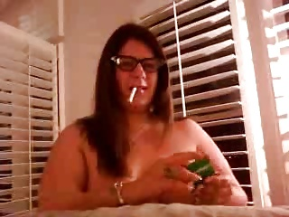 wife smoking with glasses