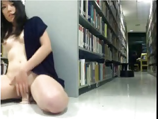 Asian amateur rides dildo in public library