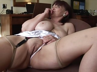 Busty mature Tanya in stockings and short dress