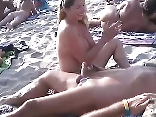Nude Strand - Focus on Handjobs relative to Pierced Nipples
